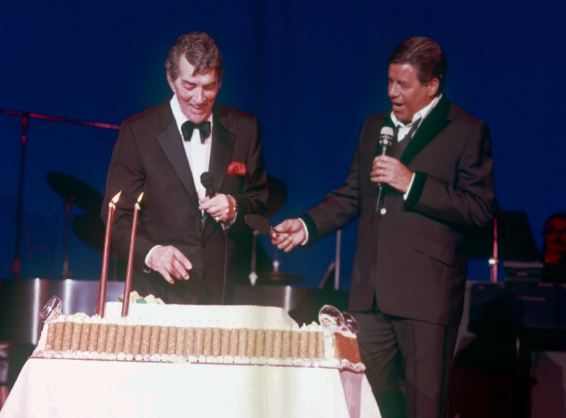 HAPPY BIRTHDAY — Steubenville's own Dean Martin, left, laughs after former partner Jerry Lewis presented the famed entertainer with a giant cake in honor of his 72nd birthday at Bally's in Las Vegas June 8, 1989. Martin died at the age of 78 at his Beverly Hills home on Christmas Day 1995.- Associated Press