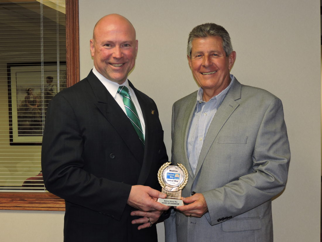 "The Weirton United Way took time to thank those involved in making its 2016 campaign a success, while preparing for the 2017 campaign season. During a dinner held Thursday at Hancock County Savings Bank, Tom McDonald, right, 2016 campaign chair, presented the ""Hands of Leadership"" to Pat Ford. Ford will serve as the United Way's 2017 campaign chair. — Craig Howell"
