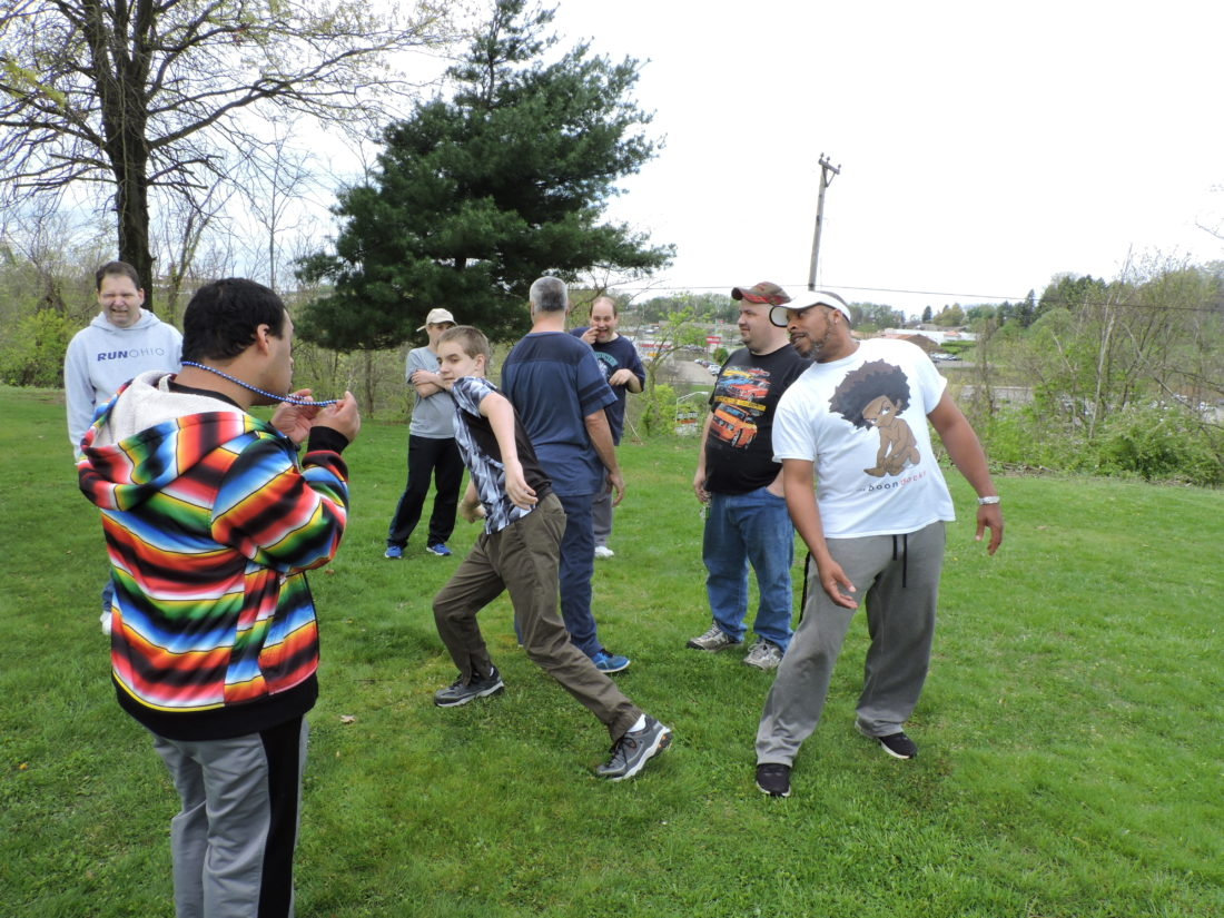 PRACTICE, PRACTICE, PRACTICE — Coach Steven Fletcher, right, a Special Olympics volunteer, was in charge of a softball throw practice held earlier this week at the School of Bright Promise. - Jody Wisbith