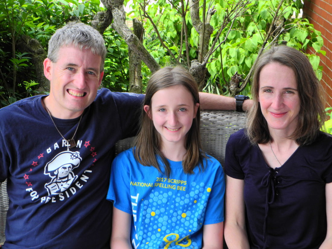 Grace McKeegan, a Heart of Mary home-schooled seventh-grader, is competing next week in the Scripps National Spelling Bee in Washington, D.C. With her are her parents, Shawn and Maura McKeegan of Steubenville. — Warren Scott