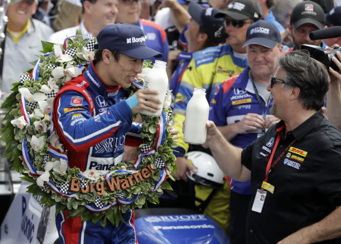 Takuma Sato of Japan, left, and car owner Michael Andretti toasted with the victor's bottle of milk in Victory Lane at the Indianapolis Motor Speedway Sunday after Sato won the 101st Indianapolis 500.