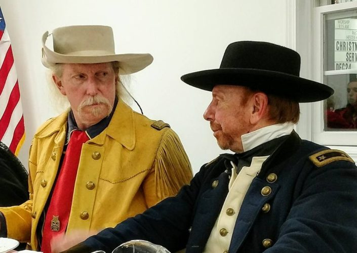 PLAYINGAROLE — Gen. George Custer, portrayed by Rich Williams, a civil War re-enactor, left, and Kris Gunvalsen, Civil War re-enactor portraying Gen. William T. Shermann, talk at a recent Custer birthday celebration. Williams will be back in his role as the boy general on Saturday for the Custer summer celebration at Custer Park in New Rumley. -- Esther McCoy