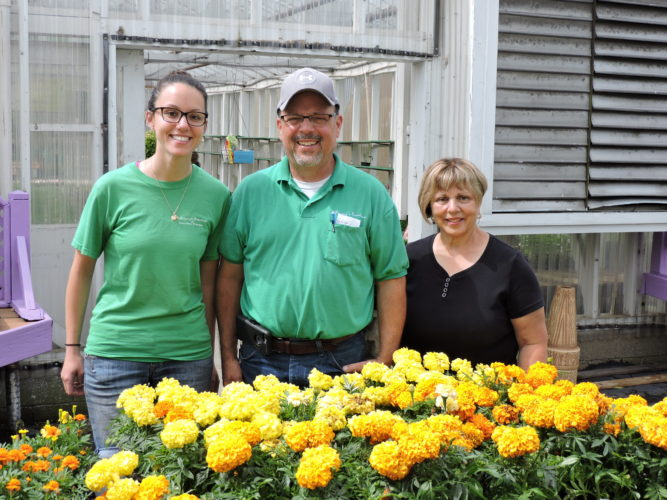 A FAMILY BUSINESS — Elizabeth DiGregory, left, stands next to her father, Lou DiGregory, and her aunt, Mara DiGregory, in the DiGregory's Greenhouse and Garden Center on Bullock Avenue in Steubenville. Elizabeth is the fourth generation to work at the business and is the retail manager of the store. -- Dave Gossett