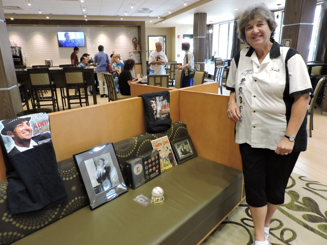 Rose Angelica, chairwoman of the Dean Martin Festival Committee, stands next to several of the items that will be featured at the Dean Martin silent auction planned from 5 p.m. to 7 p.m. Friday at the Inn at Franciscan Square on University Boulevard. Angelica said this will be her last Dean Martin Festival. — Dave Gossett