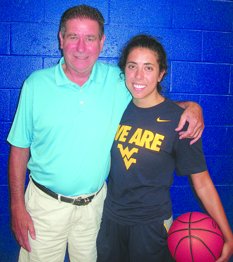 TAKING A BREAK — Liz Repella takes a break from Saturday's Camp for Cynthia at Catholic Central High School to share a moment with her dad, Gary, who will be inducted into the OVAC Hall of Fame on Aug. 19.  -- Bubba Kapral