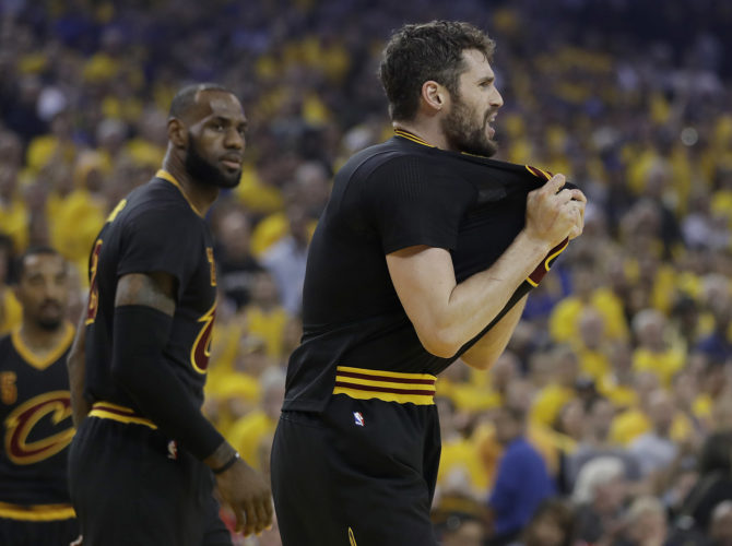 STARTING OVER — Cleveland Cavaliers forward Kevin Love, right, reacts next to forward LeBron James during the first half of Game 5 of the NBA Finals against the Golden State Warriors on June 12 in Oakland, Calif. (Associated Press)