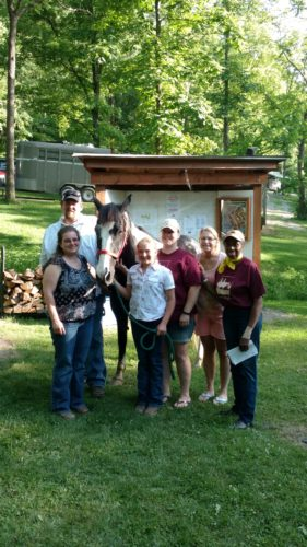 PRESENTATIONMADE — From left, James Cunningham and Melanie Cunningham are shown with their daughter, scholarship recipient Jewelene Cunningham; Dewey the wonder horse; and Brooklyn Van Curen, Faye Verhovec and Doc Bradley, members of the Harrison County Ohio Horsemen's Council and scholarship committee  who awarded Jewelene with a horse camp scholarship to Faith Ranch in Jewett. -- Contributed