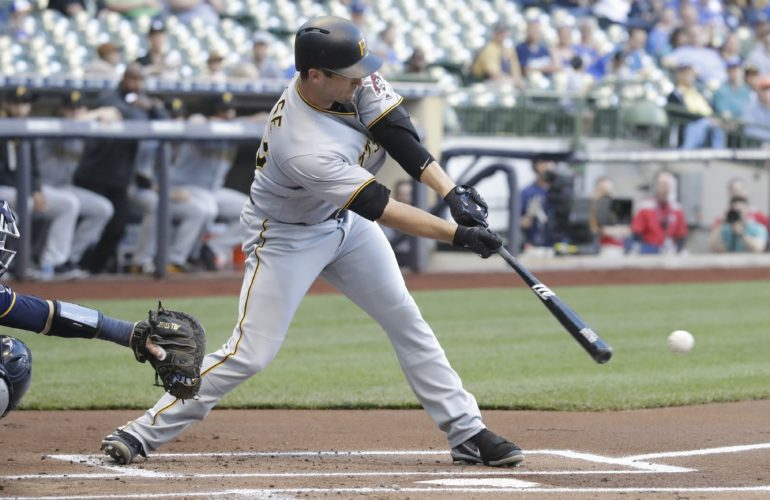 SOLID HITTING — Pittsburgh Pirates' David Freese hits an RBI single during the first inning against the Milwaukee Brewers Tuesday in Milwaukee. (Associated Press)