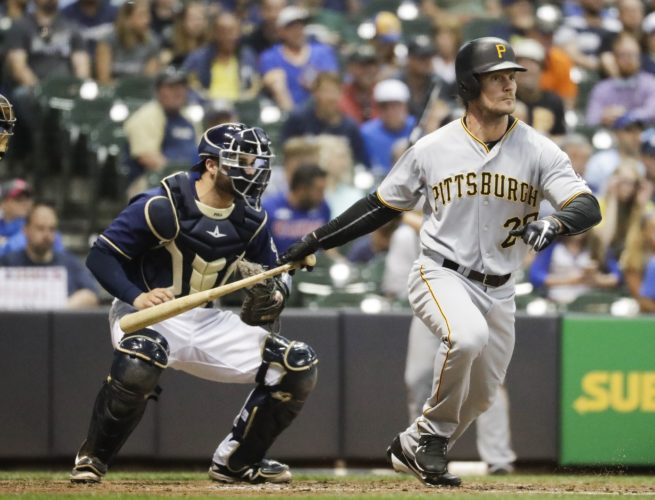 LEADING THE CHARGE — Pittsburgh Pirates' John Jaso hits an RBI double during the fifth inning against the Milwaukee Brewers Wednesday in Milwaukee. (AP Photo)