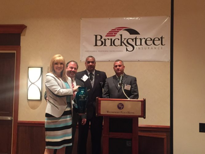 Wheeling-Nisshin Inc. was presented the 2017 BrickStreet Mutual Insurance Co. and the West Virginia Manufacturers Association's Safety Award for its outstanding safety record. On hand for the presentation at the WVMA's Marcellus to Manufacturing Conference in Morgantown in May were, from left, Lisa Hamrick, business development manager for BrickStreet; Pat Pendleton, W-N vice president of manufacturing; Jim Howard, chairman of W-N's union safety committee; and Lonny Riggs, W-N manager of environment, health and safety. — Contributed