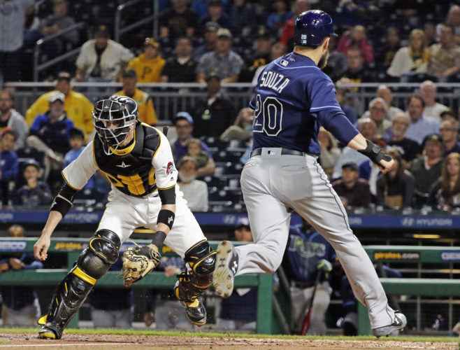 FREESE FRAME — Pittsburgh Pirates catcher Chris Stewart waits for the late relay throw as Tampa Bay Rays' Steven Souza Jr. scores from first on a error by Pirates's third baseman David Freese in the 10th inning Tuesday in Pittsburgh. The Rays won in ten innings 4-2. (AP Photo)