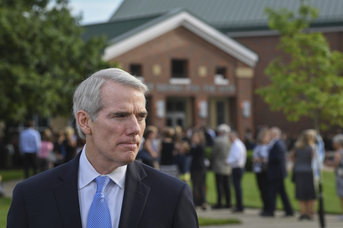 PRESSURE FOR PORTMAN — Sen. Rob Portman, R-Ohio, meets reporters before the funeral of former North Korean prisoner Otto Warmbier Thursday. Portman announced Tuesday that he is joining opposition to the Republicans' current Senate health care bill. The GOP leadership has delayed a Senate vote on the bill until after the July 4 recess. -- Associated Press