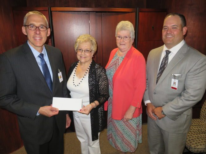 MAKINGADIFFERENCE — The Weirton Medical Center Auxiliary's annual awards dinner held July 18 was occasion for a major check presentation to the hospital along with the recognition of volunteers for their years of service to the unit. The auxiliary presented a check for $70,000 to the hospital to refurbish the WMC Atrium Cafe. On hand for the check presentation were, from left, WMC Chief Executive Officer John Frankovitch; Sondra Weigel, auxiliary president; Paula Billick, auxiliary treasurer; and David Artman, WMC chief operating officer.  -- Janice Kiaski