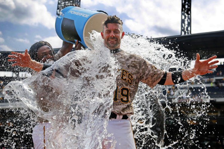 COOLING DOWN — Pittsburgh Pirates' Chris Stewart gets doused by Josh Bell as he waits to be interviewed after a 4-2 Pirates win over the Milwaukee Brewers Thursday in Pittsburgh. (AP Photo)