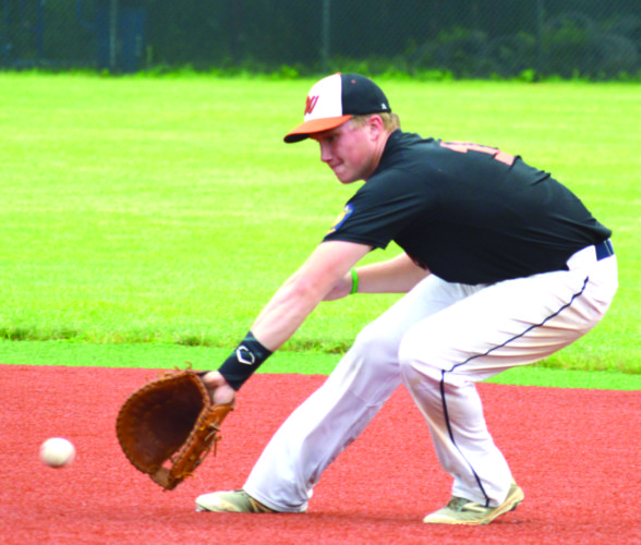 MOVING ON — Weirton's Tyler Wright fields a ground ball at first base against Moundsville on Thursday. (Photo by Cody Tomer)
