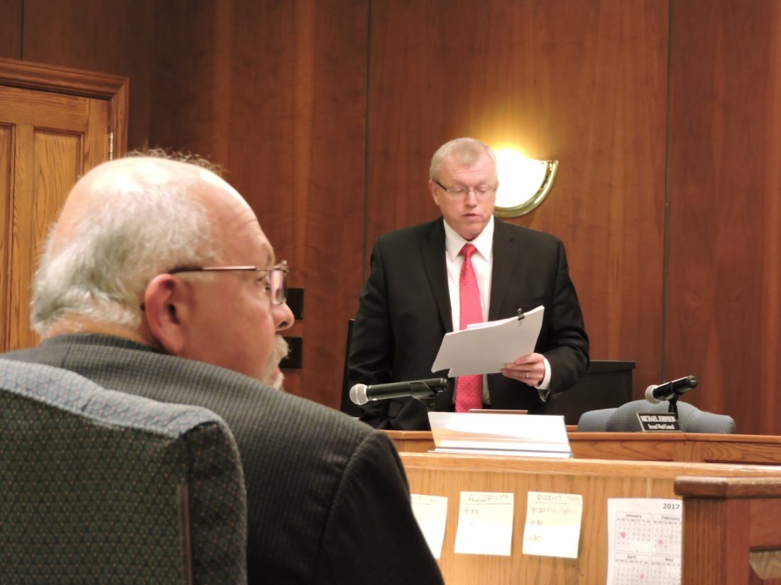 ENFORCING THE LAW — Sixth Ward Councilman Bob Villamagna, left, listened while 2nd Ward Councilman Mike Johnson read a prepared statement Tuesday night regarding a recent enforcement against crisscross parking used as a form of intimidation.  -- Dave Gossett