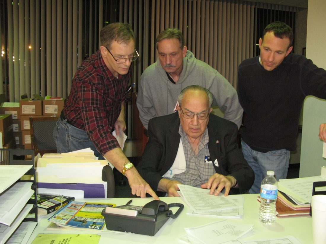 JOHN ABDALLA AT WORK — The four board members of the Jefferson County Board of Elections checked the results during the March 2016 primary election. Going over the numbers were, seated, John Abdalla; and back, from left, Frank Bruzzese, Richard Desman and Brian Wilson. Abdalla died on Monday at the age of 81.  -- Mark Law