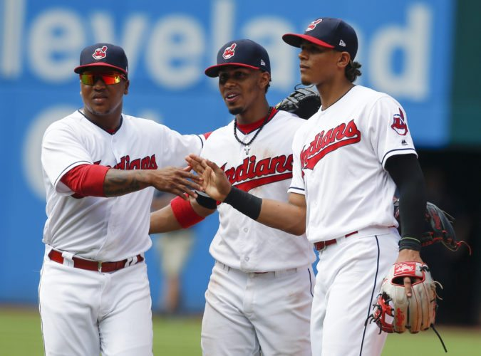 Cleveland Indians' Jose Ramirez, left, Francisco Lindor, center, and Erik Gonzalez celebrate a 2-1 win over the Los Angeles Angels in a baseball game, Thursday, July 27, 2017, in Cleveland. (AP Photo/Ron Schwane)