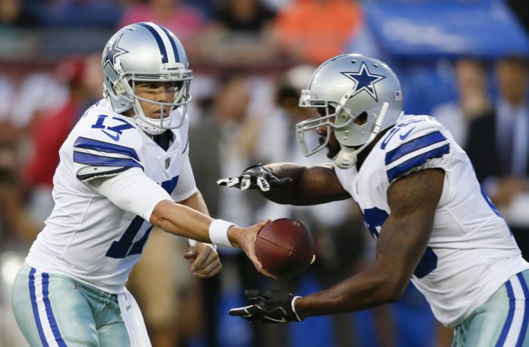 Dallas Cowboys quarterback Kellen Moore (17) hands off to running back Darren McFadden, during the first half against the Arizona Cardinals in the Pro Football Hall of Fame NFL preseason game in Canton, Ohio, Thursday, Aug. 3, 2017. (AP Photo/Ron Schwane)