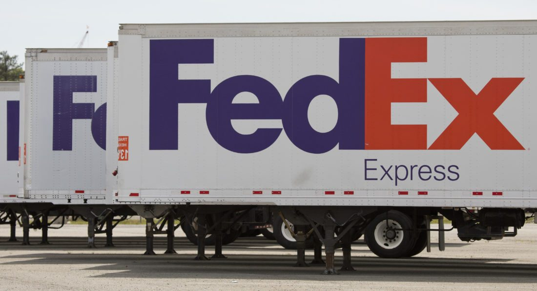 HOLIDAY DELIVERIES — FedEx Express trucks sit idle at Richmond International Airport in Sandston, Va.