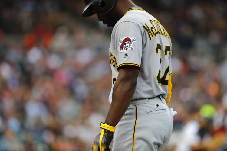 Pittsburgh Pirates' Andrew McCutchen (22) walks to the dugout after flying out against the Detroit Tigers in the fourth inning of an interleague baseball game in Detroit, Wednesday, Aug. 9, 2017. (AP Photo/Paul Sancya)