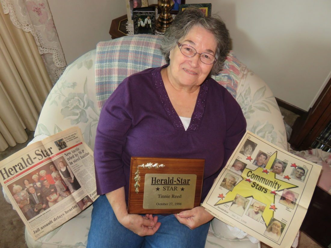 FOND MEMORIES — Tinnie Reed of Wintersville was among the first group of honorees when the Herald-Star and The Weirton Daily Times launched their Community Stars program to honor unsung heroes of the Tri-State Area. A former longtime volunteer at Urban Mission Ministries, Reed displays some memorabilia from the event. Nominations are being accepted through Wednesday for the newspapers' 20th installment of Community Stars. -- Janice Kiaski