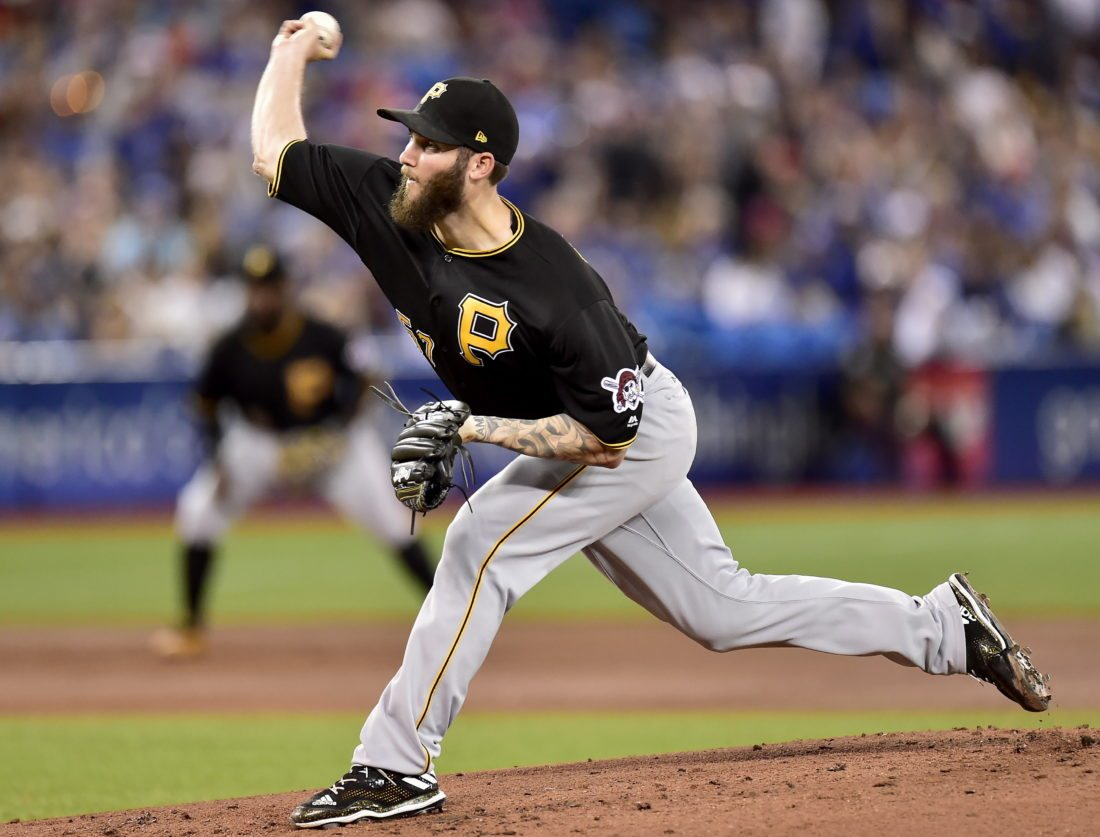 Pittsburgh Pirates starting pitcher Trevor Williams (57) works during the first inning of a baseball game against the Toronto Blue Jays in Toronto on Saturday, Aug. 12, 2017. (Frank Gunn/The Canadian Press via AP)