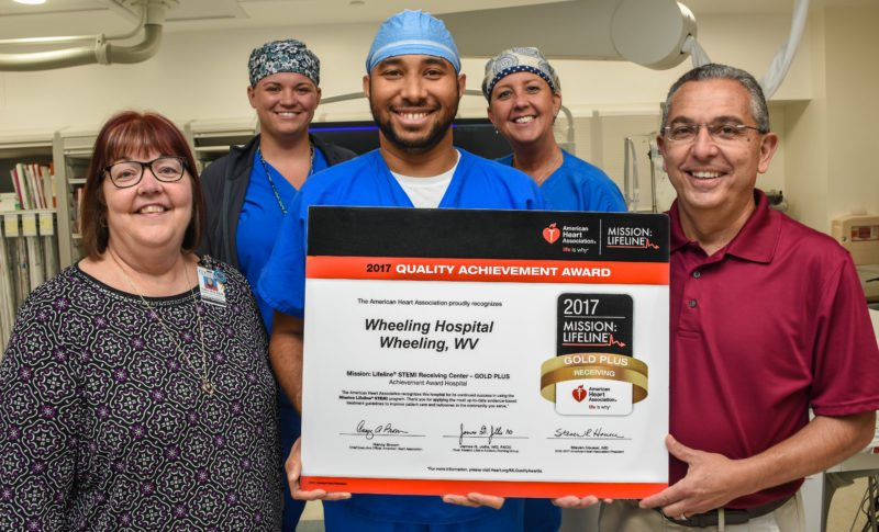AWARD — Several members of Wheeling Hospital's Cardiac Catheterization Lab display an award from the American Heart Association for treating the severest type of heart attacks. Showing off the award are, from left, Patricia Holden, quality coordinator, Mission: Lifeline Regional Team Leader; lab supervisor Jenna Linton; interventional cardiologist Dr. Gregory Suero; Elaine Donaldson, registered nurse; and interventional cardiologist Dr. Adel Frenn. -- Contributed
