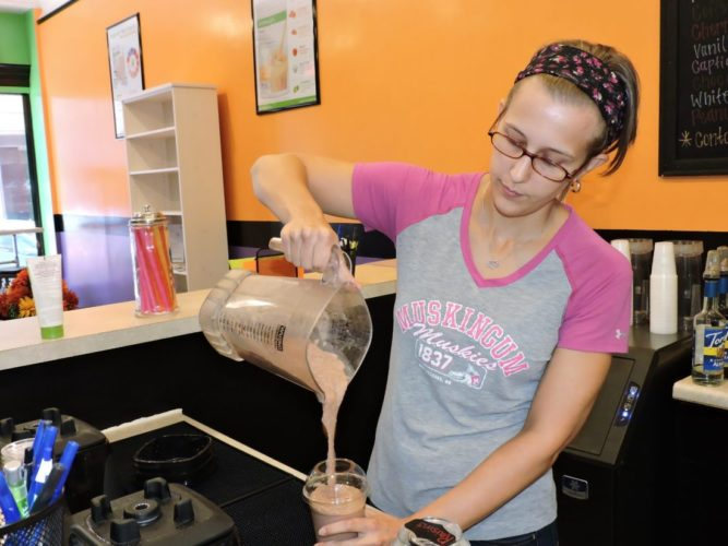 BEST IN BUSINESS — Kahlie Lewis, owner of the Healthy Vibes For You nutrition club near Wheeling's Centre Market, mixes a smoothie at the shop she and husband, Kyle, opened this year. The national finance website WalletHub ranks Wheeling No. 61 out of more than 1,200 cities across the U.S. as the best in which to start a new business. -- Casey Junkins