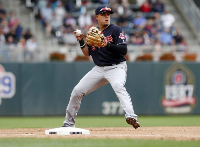 Cleveland Indians third baseman Giovanny Ursula fields a grounder against the Minnesota Twins in the first game of a baseball doubleheader Thursday, Aug. 17, 2017, in Minneapolis. (AP Photo/Jim Mone)