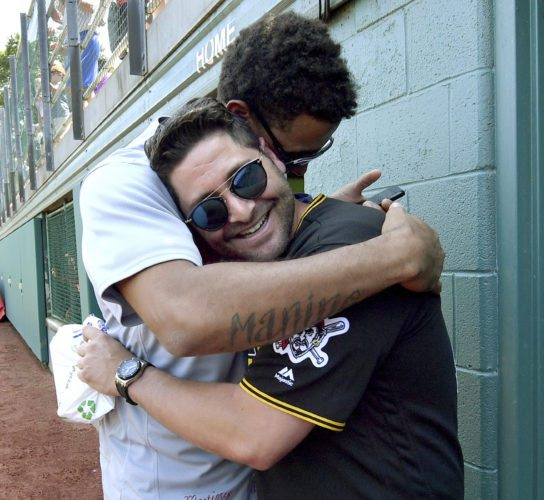 CAMARADERIE — Pittsburgh catcher Francisco Cervelli, right, hugs St. Louis Cardinals pitcher Jose Martinez Sunday at Volunteer Stadium in Williamsport, Pa., as they make an appearance at the Little League world Series.  -- Associated Press