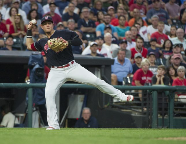 Cleveland Indians' Giovanny Urshela throws out Boston Red Sox' Christian Vazquez at first, during the fourth inning of a baseball game in Cleveland, Monday Aug. 21, 2017. (AP Photo/Phil Long)