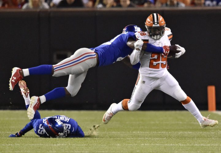 Cleveland Browns running back Duke Johnson (29) rushes as New York Giants cornerback Dominique Rodgers-Cromartie (41) dives for the tackle in the first half of an NFL preseason football game, Monday, Aug. 21, 2017, in Cleveland. (AP Photo/David Richard)