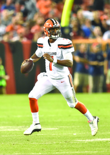 BUILDING DRAMA — Cleveland Browns quarterback DeShone Kizer looks to pass against the New York Giants Monday in Cleveland. The Browns won 10-6. (AP Photo)