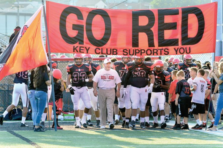 TAKING CHARGE — Steubenville head coach Reno Saccoccia leads his Big Red on the field before their matchup with Upper St. Clair on Friday at Harding Stadium. (Photo by Michael D. McElwain)