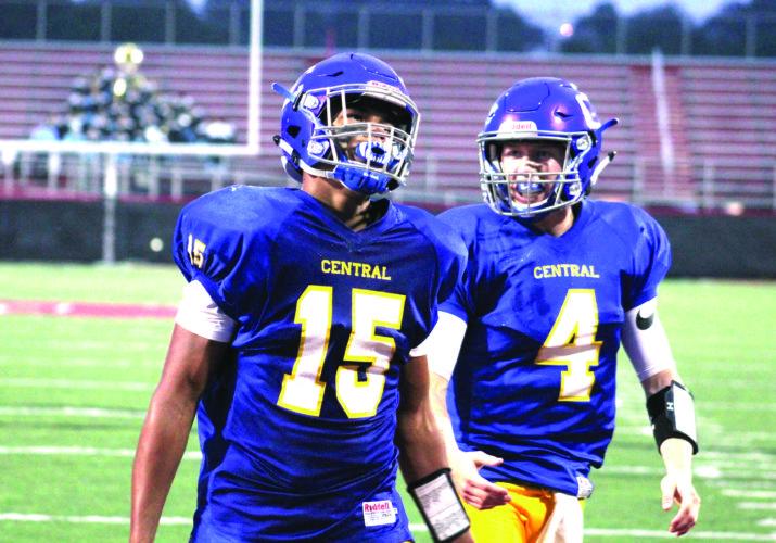 CELEBRATION — Steubenville Catholic Central's Levi Thompson (15) celebrates a touchdown with quarterback Justin Hartzell (4) against Oak Glen on Saturday. (Photo by Joe Catullo)