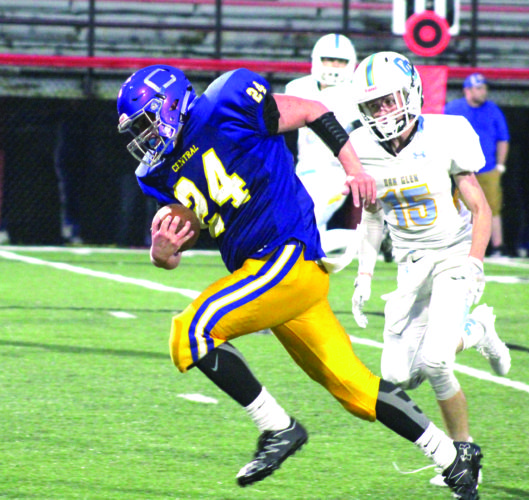 TOUCHDOWN RUN — Steubenville Catholic Central's Dom Argentine rushes for a touchdown past Oak Glen's Michael Lemley on Sept. 2. (Photo by Joe Catullo)