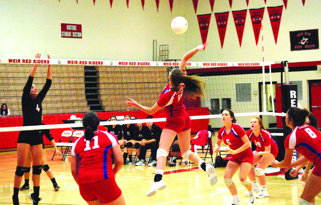 SKY HIGH — Toronto's Jenna Leasure attempts a kill past Weir's Sophia Mikula on Wednesday. Also shown are Toronto's Riley Kinsey (5), Leslie Phillips (19), Jamie Anderson (8) and Gina Fogle (11). (Photo by Andrew Grimm)