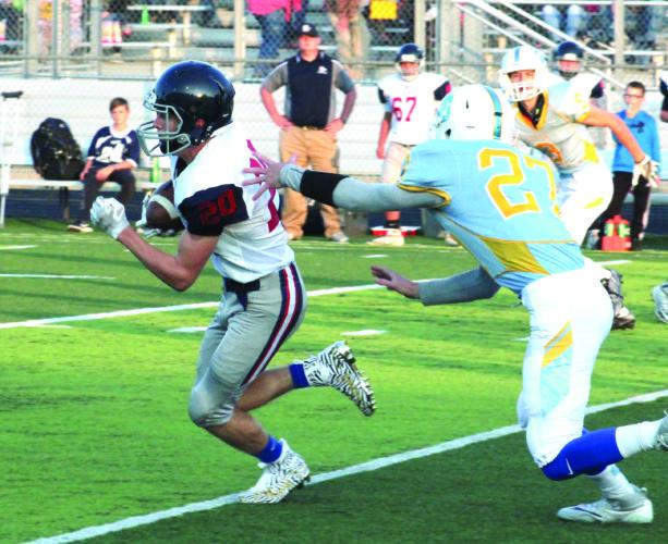 FINDING ROOM — Buckeye Local's John Marelli rushes against Oak Glen on Sept. 8 (photo by Joe Catullo).
