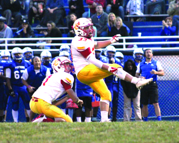 DOWN THE MIDDLE — Indian Creek's Brandon Hiles kicks a field goal with Sam Mazar holding against East Liverpool on Sept. 1 (photo by Joe Catullo).