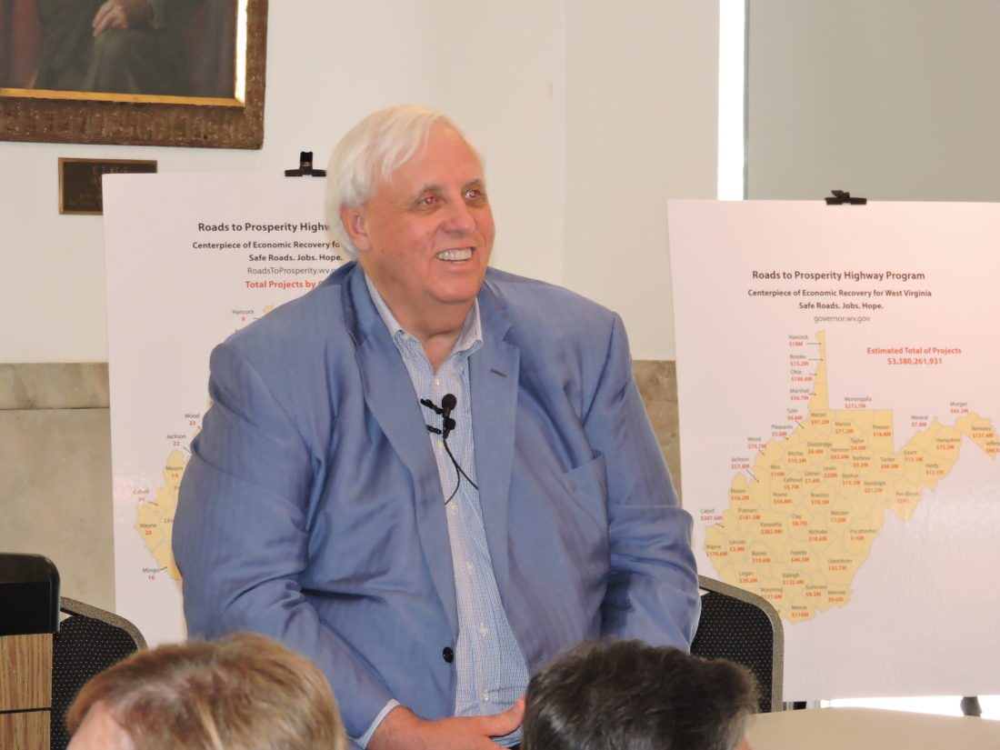 AREA VISIT — Gov. Jim Justice sat before a crowd of more than 70 in the Weirton Room of the Millsop Community Center Wednesday evening, promoting the Roads to Prosperity road bond proposal which will go before the voters on Oct. 7. Early voting is set to begin Friday. -- Craig Howell