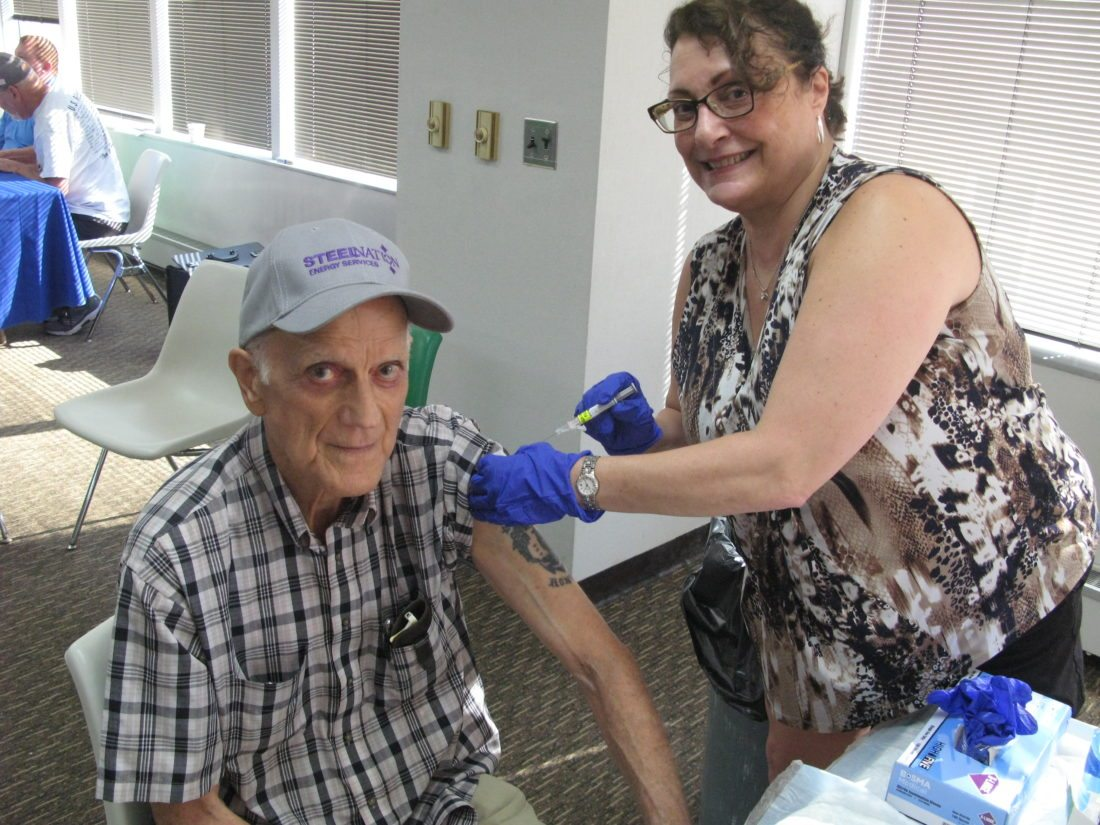 FLU SHOT — Paul Swickard of Steubenville gets a flu shot on Saturday morning from Tina Griffel of the VA Pittsburgh Healthcare System during the annual Veterans Health and Information Fair at the Towers. The health fair was sponsored by the Jefferson County Veterans Service Commission.