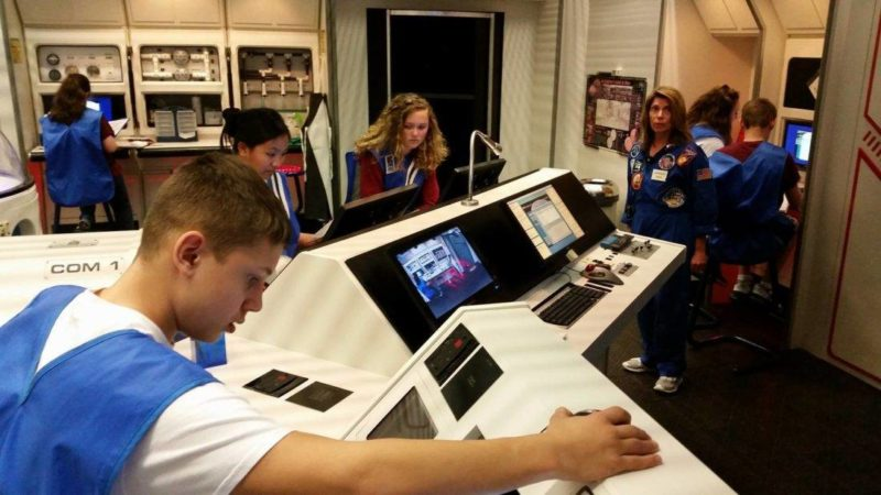 AT THE CENTER — Students take on a mission while visiting the Challenger Center at Wheeling Jesuit University.