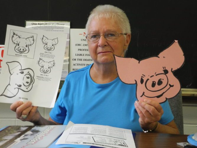 PROGRAMMATERIAL — Connie Crawford, a member of the Jefferson County Farm Bureau Promotion and Education Committee, displays some of the material for the Farm to School program being planned for later in the year for school children in the county. The pig program for fourth-graders will involve a  pig from the Finney Hog Farm in Mount Pleasant.   -- Contributed