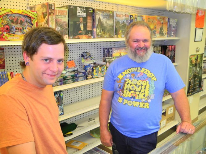 Will Poling, manager of the Game Shack in Follansbee, and his father Steve, shop owner; stock a variety of games to appeal to players of various ages and interests and hundreds of new comic books and graphic novels, including Marvel, DC, independents and Manga. — Warren Scott