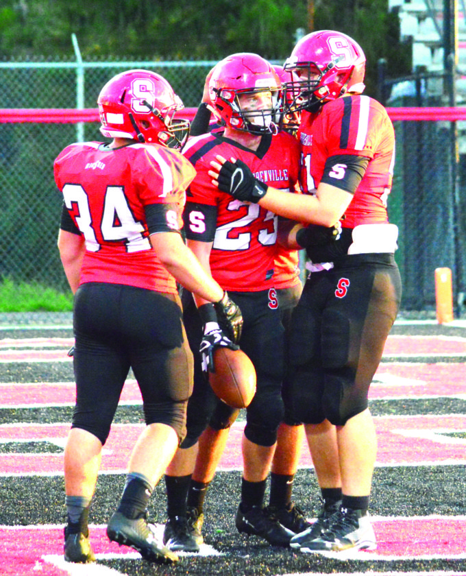 GROUP CELEBRATION — Steubenville's Jacob Bernard (25) celebrates with teammates after scoring a touchdown against St. Joseph's Catholic on Sept. 8 at Harding Stadium. (Photo by Michael D. McElwain)