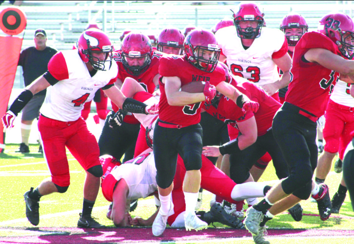 RUNNING ROOM — Weir's Garet Hostuttler rushes against Petersburg on Sept. 23. (Photo by Joe Catullo)