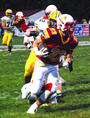 RUNNING BY — Indian Creek's Trevor Fante rushes past Brooke's Carson Secrist on Friday. (Photo by Andrew Grimm)