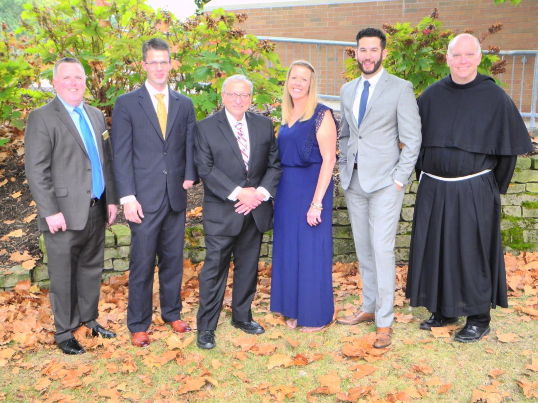 Recognized Friday for their service to the Franciscan University of Steubenville, the community and church were, from left, Timothy Delaney, the university's director of alumni and constituent relations; honorees Stephen Wallace, Dr. Frank Petrola, Rosemary Anderson and Rocco Ambrosio; and the Rev. Sean Sheridan, TOR, the university's president. The Rev. Jeffrey Kirby, a 1999 graduate of the school, also was honored. — Warren Scott