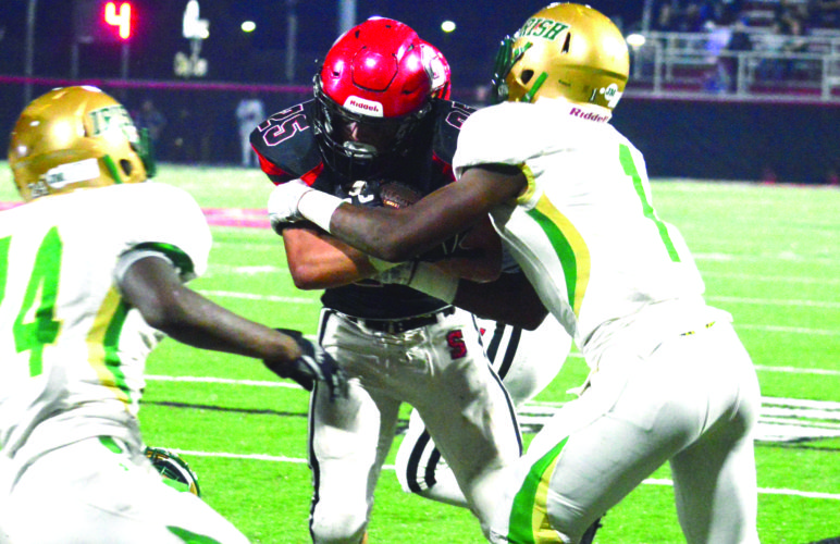 Steubenville's Jacob Bernard fights for yards against Youngstown Ursuline on Friday. (Photo by Michael D. McElwain)